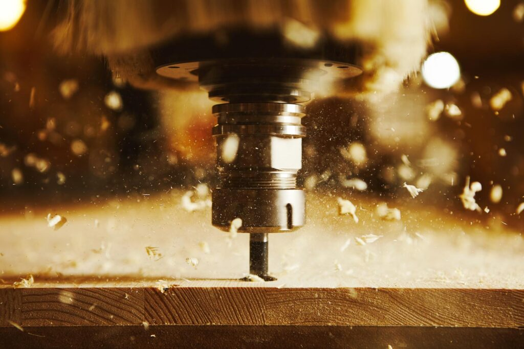 Close-up shot of machine with numerical control cuts wood. Cnc tool.