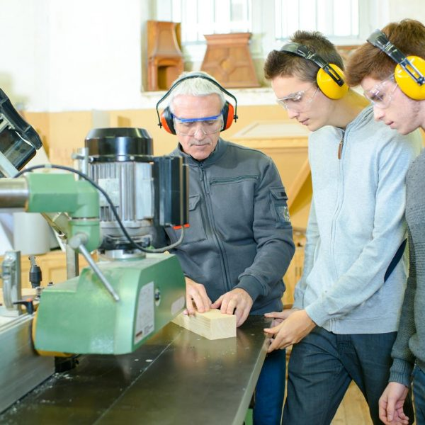 senior and young men - woodwork apprenticeship